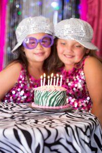 2 girls and black and white cake