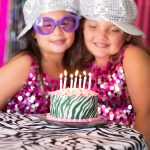 2 girls and black and white cake